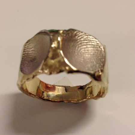 Grillige gouden ring met twee vingerafdrukken